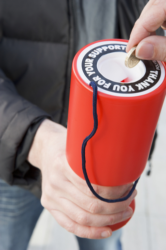 attract money by giving some to charity